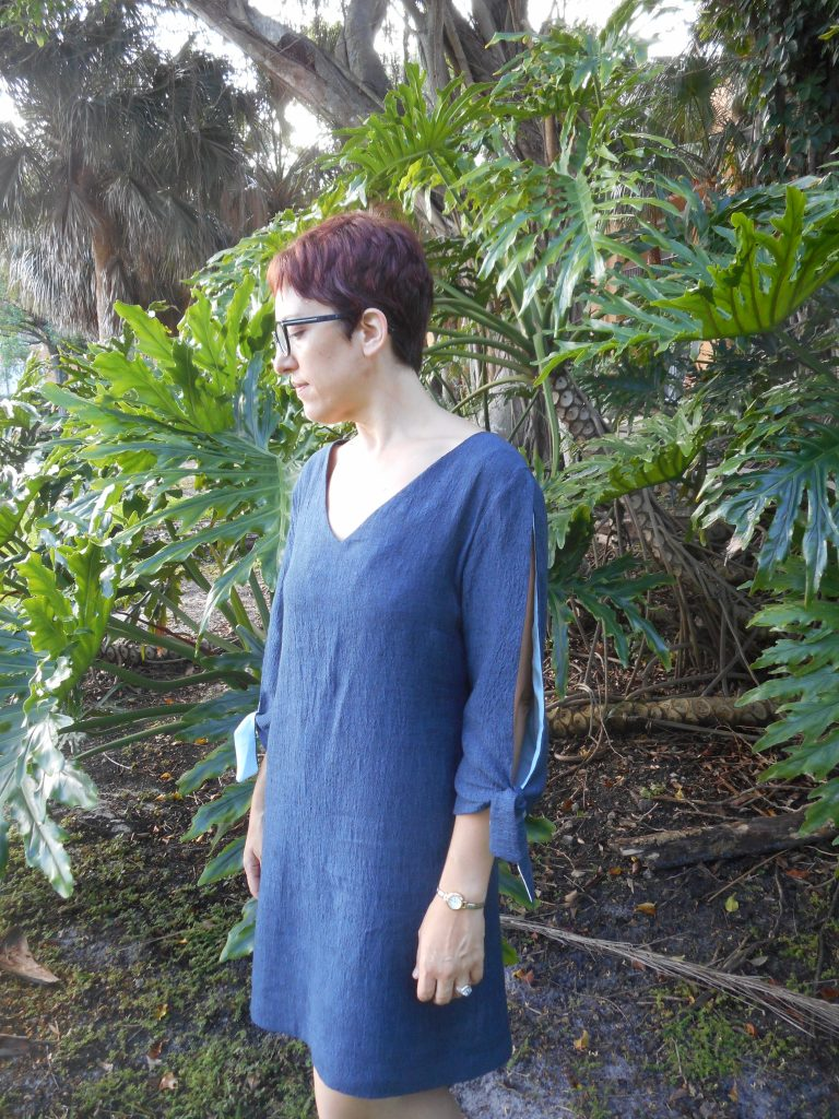 667455e2a1 I love the bit of light blue silk that peeks out though it was totally  unintentional. I ran out of fabric and had to use an older dress to line  the sleeves.
